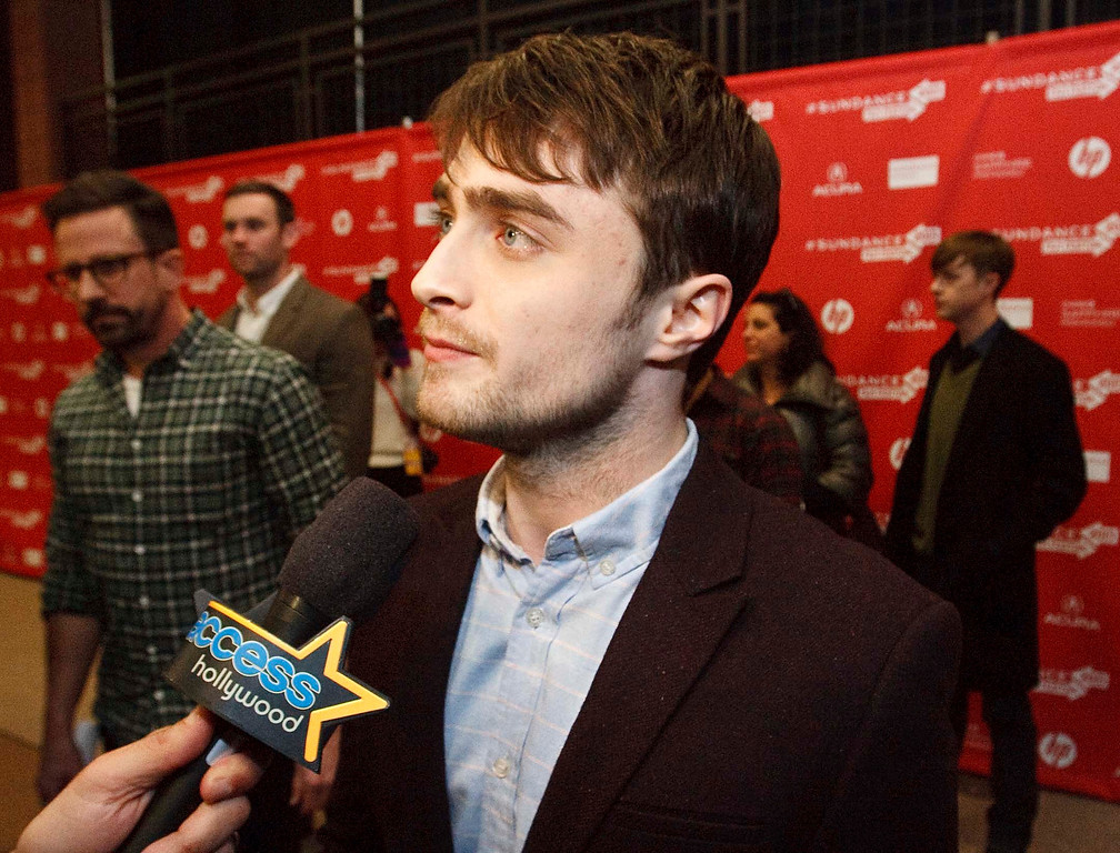 Description of . Daniel Radcliffe fields questions from the media before the premiere of