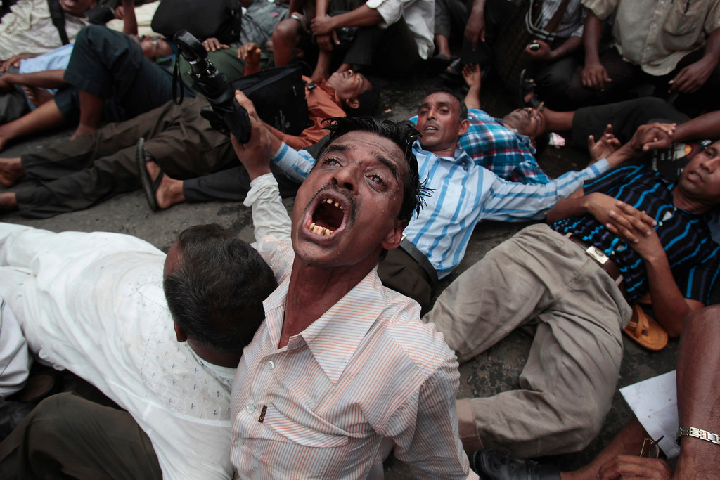 Description of . A non-government school teacher shouts slogans during a protest in Dhaka May 15, 2012. Bangladeshi police on Tuesday used water cannon and batons to disperse hundreds of non-government school teachers who were taking part in the protest while detaining at least fifteen. The protesters were demanding for the nationalization of their jobs and a pay rise in line with government primary school teachers, according to the Non-Government Primary Teachers' Association.  REUTERS/Andrew Biraj