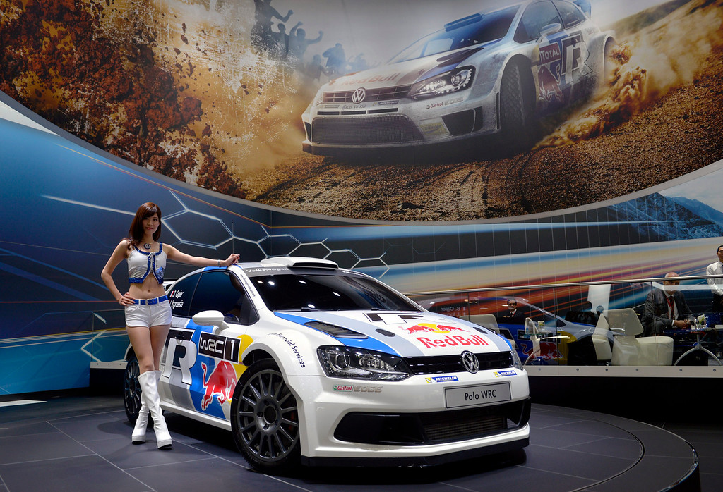 Description of . A model poses next to Volkswagen's Polo WRC at the 43rd Tokyo Motor Show 2013 in Tokyo, Japan, 20 November 2013. The 43rd Tokyo Motor Show 2013 will be open to the public from 22 November to 01 December 2013.  EPA/FRANCK ROBICHON