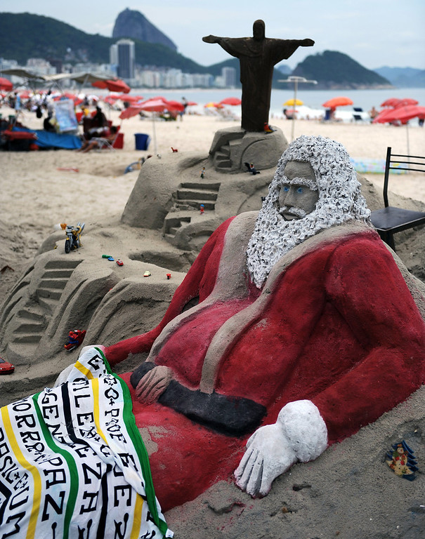 Description of . View of a sand sculpture depicting Santa Claus at Copacabana beach in Rio de Janeirro, Brazil on December 12, 2012. High temperatures -35 to 38 degrees celcius- during the end of the spring, have taken citizens and tourists to the beaches of Rio de Janeiro.  VANDERLEI ALMEIDA/AFP/Getty Images