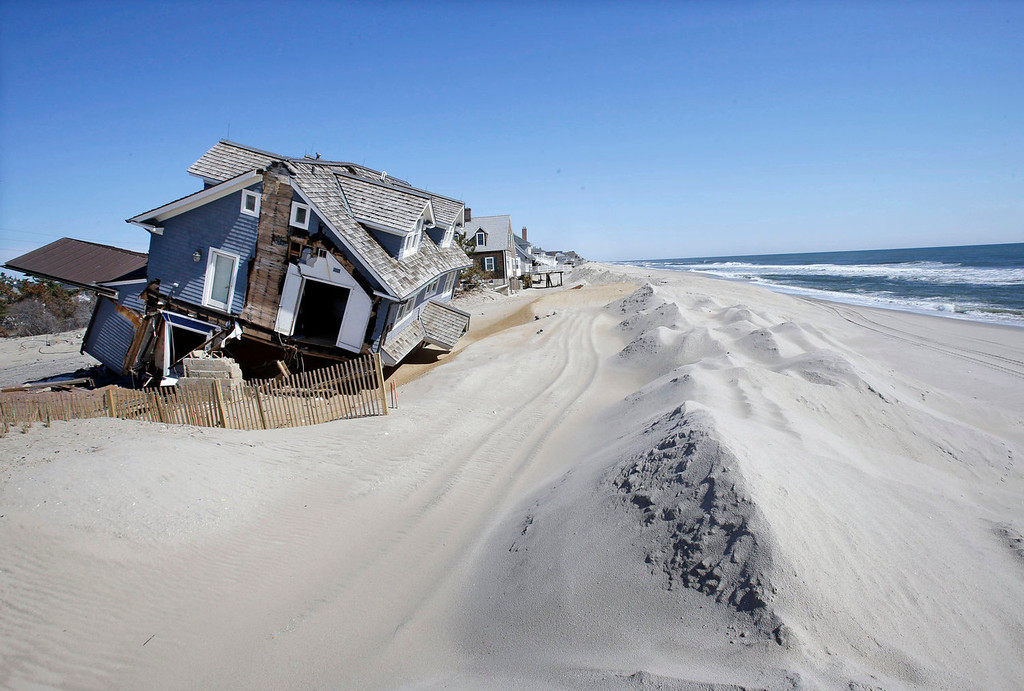 . Homes severely damaged  by Superstorm Sandy, are seen along the beach in Mantoloking, N.J. on April 25, 2013. Mantoloking and Ocean City N.J. are moving soon in court to seize control of narrow strips of beachfront land from property owners whose refusal to grant permission for the work has been blocking a desperately needed protective dune system along New Jersey\'s 127-mile coast. (AP Photo/Mel Evans)