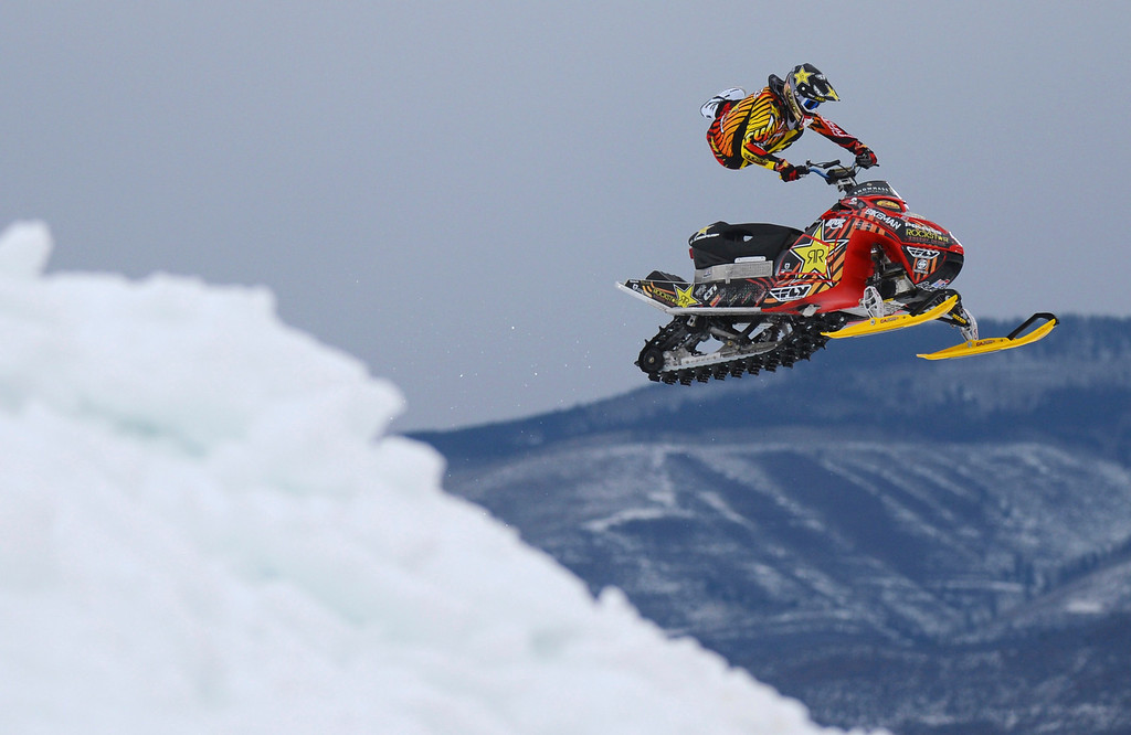 Description of . ASPEN, CO. - JANUARY 24:  Caleb Moore practices for Snowmobile Freestyle, January 24, 2013,during the 2013. Winter X Games in Aspen. Caleb will compete, along with his brother Colten Moore, in the Snowmobile Freestyle Finals. (Photo By RJ Sangosti / The Denver Post)