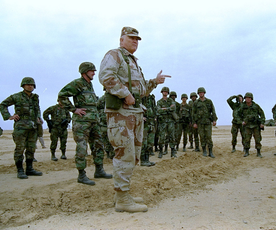 Description of . Gen. H. Norman Schwarzkopf is shown at ease with his tank troops at Operation Desert Storm in Saudi Arabia, January 12, 1991.  (AP Photo/Bob Daugherty)