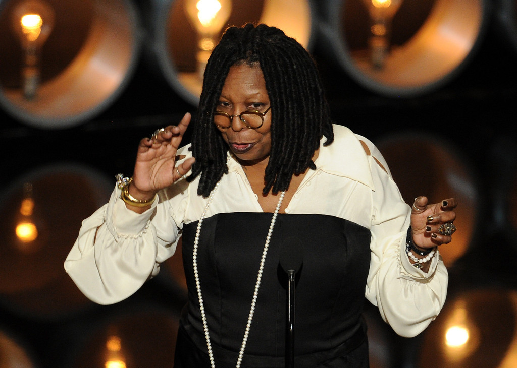 Description of . TV personality/actress Whoopi Goldberg speaks onstage during the Oscars at the Dolby Theatre on March 2, 2014 in Hollywood, California.  (Photo by Kevin Winter/Getty Images)
