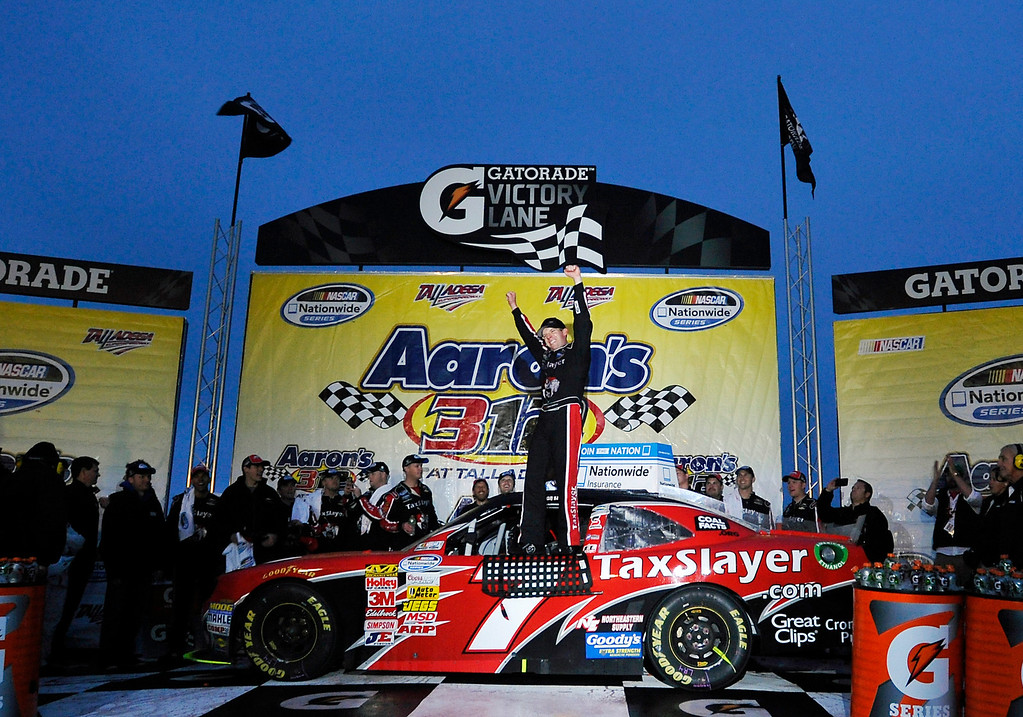 Description of . Driver Regan Smith celebrates in Victory Lane after winning the NASCAR Nationwide Series auto race at the Talladega Superspeedway in Talladega, Ala., Saturday, May 4, 2013. (AP Photo/Rainier Ehrhardt)
