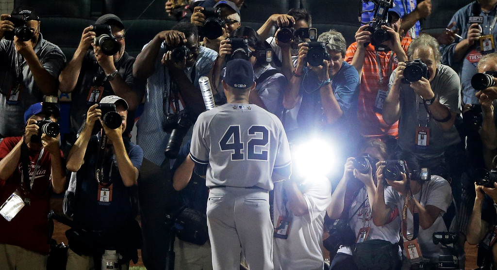 Description of . American League\'s Mariano Rivera, of the New York Yankees, poses for photographers after the MLB All-Star baseball game, on Tuesday, July 16, 2013, in New York. Rivera was named the game\'s MVP. (AP Photo/Frank Franklin II)
