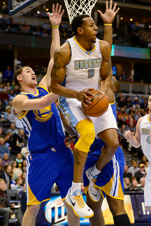 Description of . Golden State Warriors shooting guard Klay Thompson (11) pressures Denver Nuggets shooting guard Andre Iguodala (9) during the first half at the Pepsi Center on Sunday, January 13, 2013. AAron Ontiveroz, The Denver Post