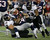 New England Patriots running back Shane Vereen (34) is tackled by Baltimore Ravens defensive end Haloti Ngata (92) and Ray Lewis (52) during the first half of the NFL football AFC Championship football game in Foxborough, Mass., Sunday, Jan. 20, 2013. (AP Photo/Steven Senne)