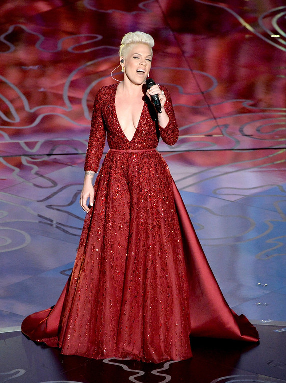 Description of . Singer Pink performs onstage during the Oscars at the Dolby Theatre on March 2, 2014 in Hollywood, California.  (Photo by Kevin Winter/Getty Images)