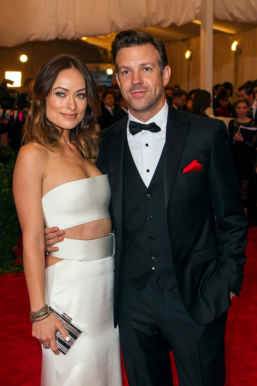 Description of . Actress Olivia Wilde arrives with Jason Sudeikis at the Metropolitan Museum of Art Costume Institute Benefit celebrating the opening of