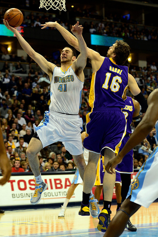 Description of . Los Angeles Lakers power forward Pau Gasol (16) defends Denver Nuggets center Kosta Koufos (41) during the first half at the Pepsi Center on Wednesday, December 26, 2012. AAron Ontiveroz, The Denver Post