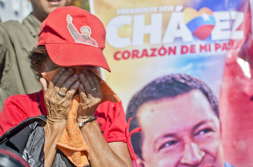 Description of . A supporter of the late President Hugo Chavez weeps outside of his funeral in Caracas, on March 8, 2013. Late Venezuelan president Hugo Chavez will be moved to a barracks where he will lie in state for longer than had been planned, then be embalmed