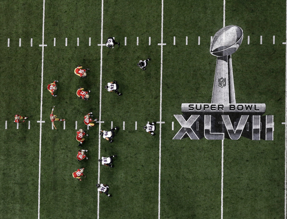 Description of . Players line up on the field during the first half of the NFL Super Bowl XLVII football game between the San Francisco 49ers and the Baltimore Ravens, Sunday, Feb. 3, 2013, in New Orleans. (AP Photo/Tim Donnelly)