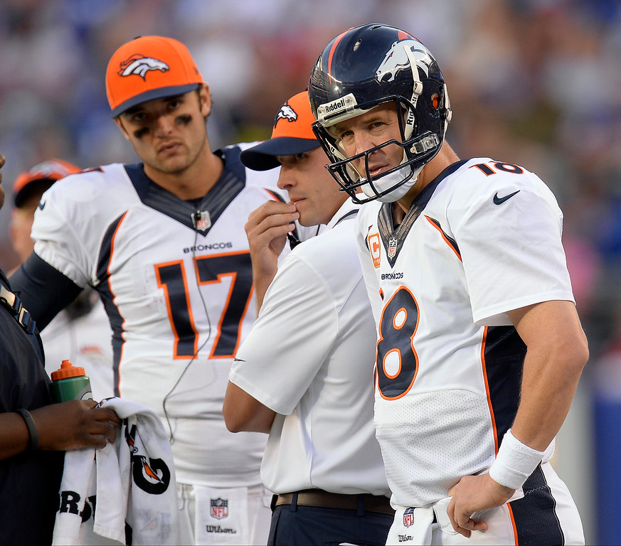 Description of . Denver Broncos quarterback Peyton Manning (18) looks a the scoreboard during a timeout during the second quarter September 15, 2013 MetLife Stadium. (Photo by John Leyba/The Denver Post)