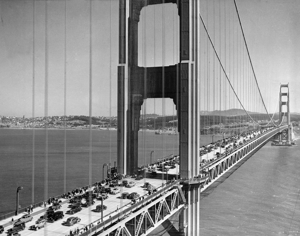 Description of . Morning commute traffic from Marin County enroute to San Francisco is seen, July 1, 1952.  The bridge was then carrying approximately 11 million vehicles a year. (AP Photo/Ernest K. Bennett)
