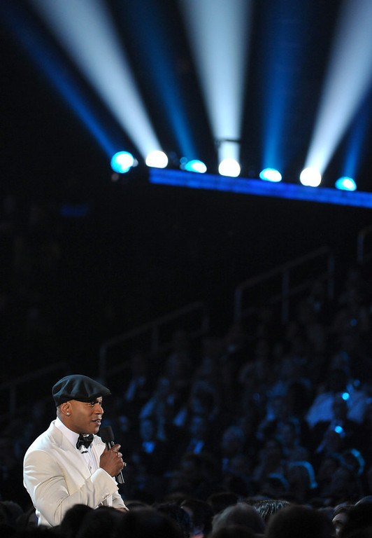 Description of . Host LL Cool J speaks during the 55th annual Grammy Awards on Sunday, Feb. 10, 2013, in Los Angeles. (Photo by John Shearer/Invision/AP)