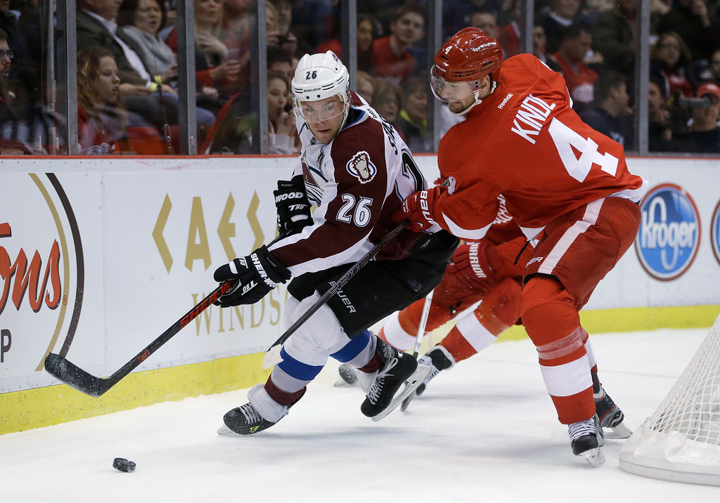 Description of . Colorado Avalanche center Paul Stastny (26) and Detroit Red Wings defenseman Jakub Kindl (4), of the Czech Republic, vie for the puck during the first period of an NHL hockey game in Detroit, Tuesday, March 5, 2013. (AP Photo/Carlos Osorio)
