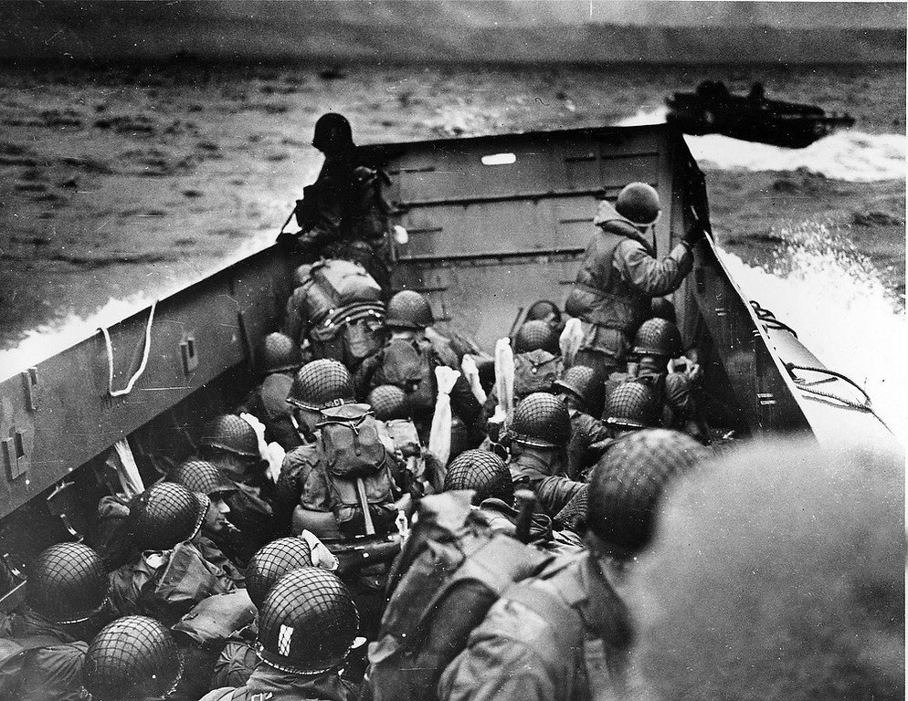 Description of . A U.S. Coast Guard landing barge, tightly packed with helmeted soldiers, approaches the shore at Normandy, France, during initial Allied landing operations, in this June 6, 1944 file photo.(AP Photo, File)