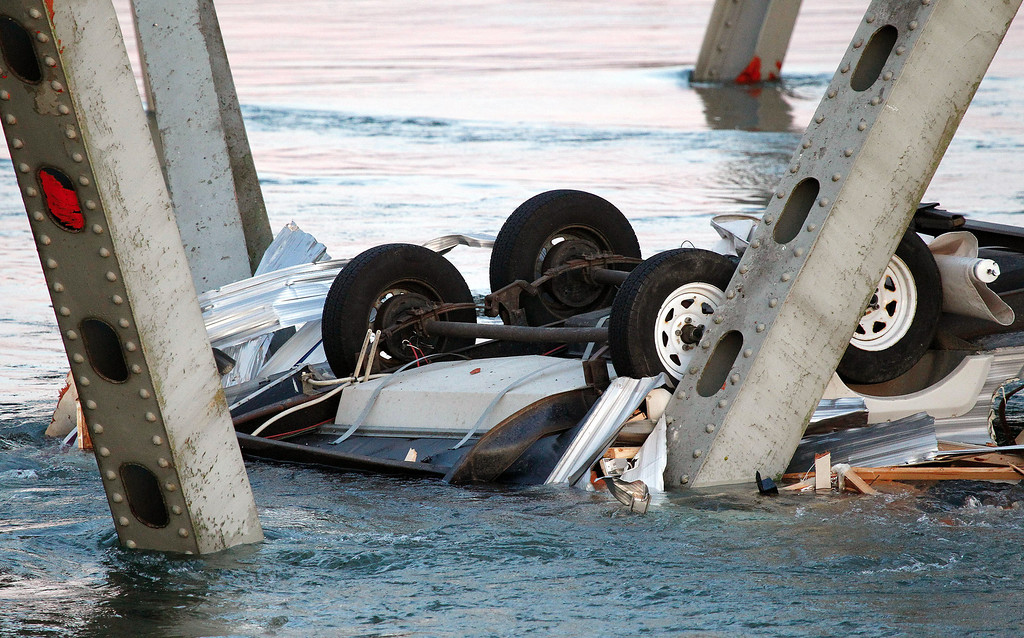 Description of . An upside down vehicle rests in the water after a portion of the Interstate 5 bridge collapsed into the Skagit River in Mount Vernon, Wash., Thursday, May 23, 2013. (AP Photo/Everett Daily Herald, Jennifer Buchanan)