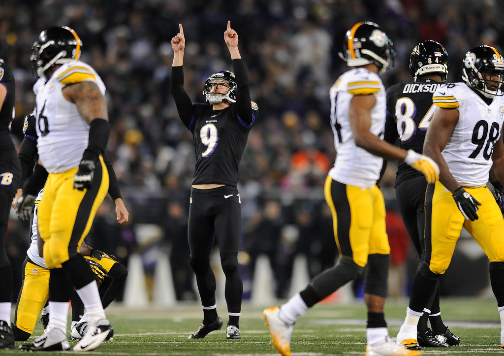 Description of . Baltimore Ravens kicker Justin Tucker (9) reacts after making a 43-yard field goal in the first half of an NFL football game against the Pittsburgh Steelers, Thursday, Nov. 28, 2013, in Baltimore. (AP Photo/Gail Burton)