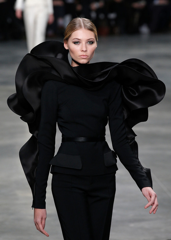 Description of . A model presents a creation by French fashion designer Stephane Rolland  for his Spring Summer 2013 Haute Couture fashion collection, presented in Paris, Tuesday, Jan.22, 2013. (AP Photo/Christophe Ena)