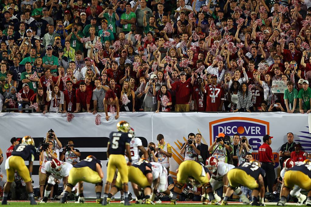 Description of . MIAMI GARDENS, FL - JANUARY 07:  Fans of the Alabama Crimson Tide cheers as Everett Golson #5 of the Notre Dame Fighting Irish lines up behind center during the 2013 Discover BCS National Championship game at Sun Life Stadium on January 7, 2013 in Miami Gardens, Florida.  (Photo by Mike Ehrmann/Getty Images)