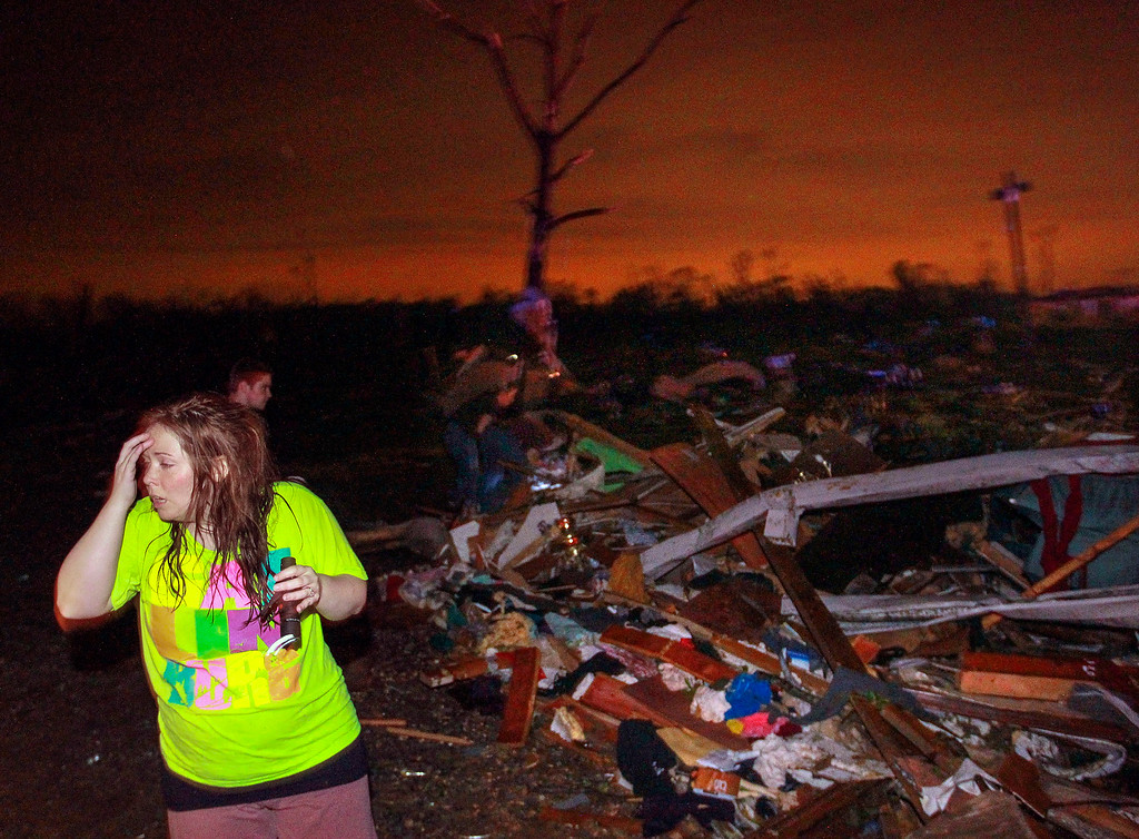 Description of . In this Sunday, April 27, 2014 photo, Lauren Watts searches for her dog in Mayflower, Ark., after a tornado struck the town. (AP Photo/The Arkansas Democrat-Gazette, Benjamin Krain)