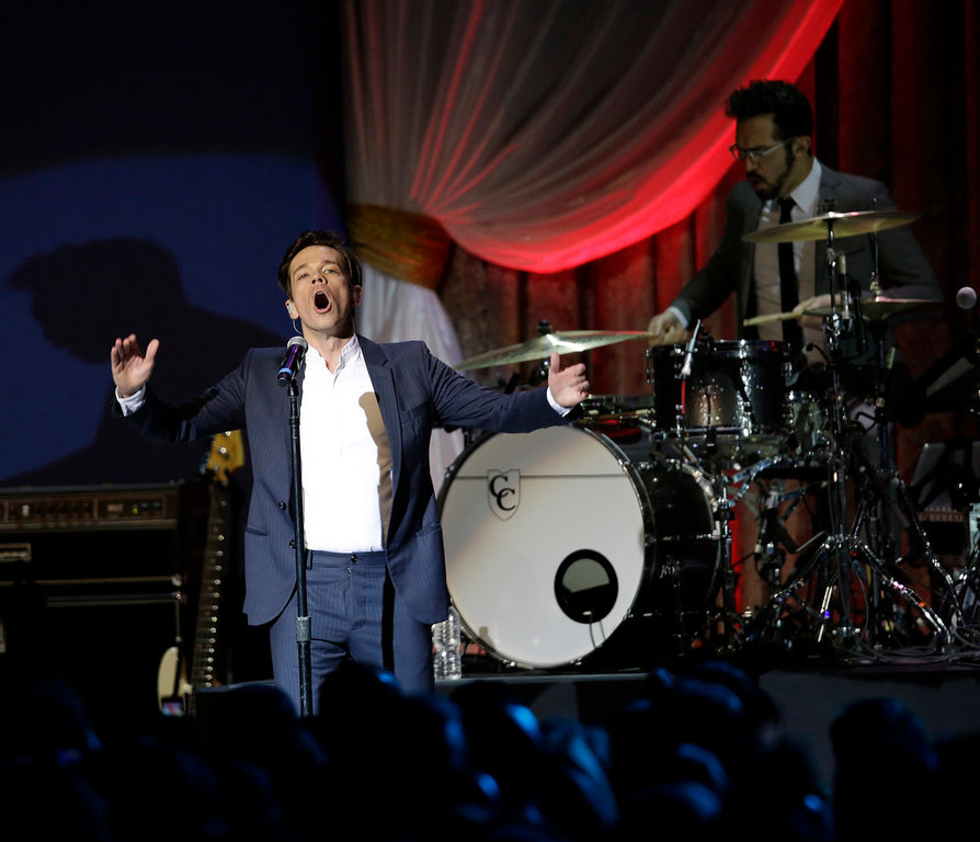Description of . Fun performs during The Inaugural Ball at the Washington convention center during the 57th Presidential Inauguration in Washington, Monday, Jan. 21, 2013. (AP Photo/Paul Sancya)