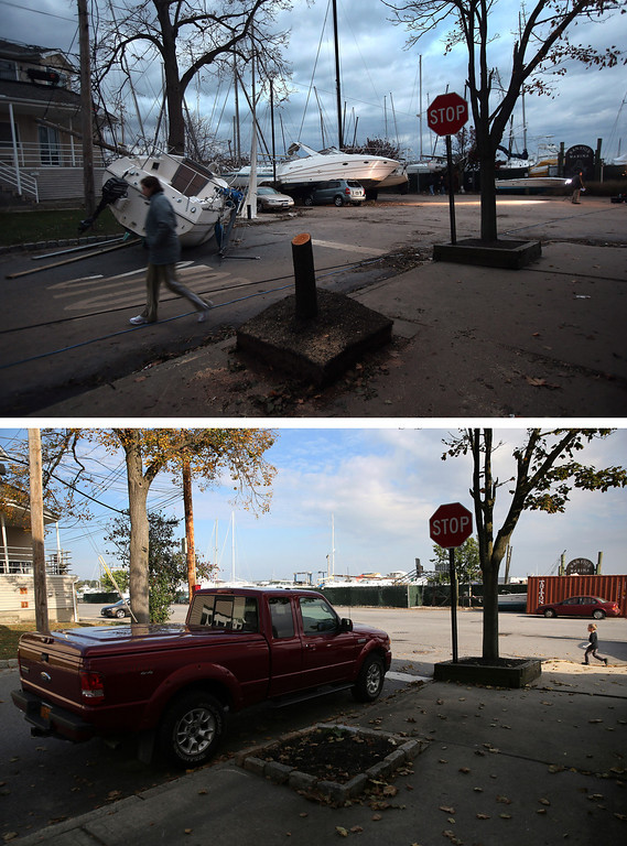 Description of . NEW YORK, NY - NOVEMBER 02: (top) Boats pushed up by Hurricane Sandy lie against residences near a marina on November 2, 2012 in the Staten Island borough of New York City.   NEW YORK, NY - OCTOBER 17:  (bottom)  A truck sits parked near a marina on October 17, 2013 in the Staten Island borough of New York City. Hurricane Sandy made landfall on October 29, 2012 near Brigantine, New Jersey and affected 24 states from Florida to Maine and cost the country an estimated $65 billion.   (Photos by John Moore/Getty Images)