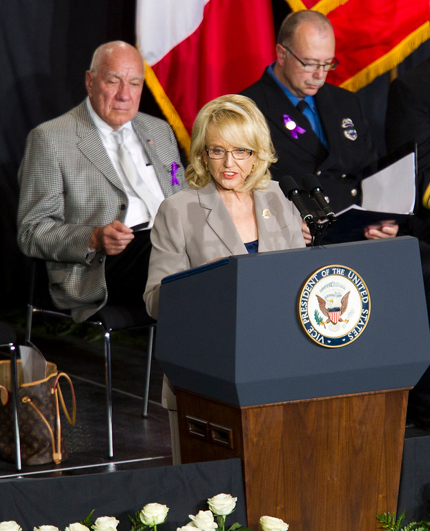 Description of . Arizona Gov. Jan Brewer speaks during a memorial service for the 19 fallen firefighters at Tim's Toyota Center in Prescott Valley, Ariz. on Tuesday, July 9, 2013.     (AP Photo/The Arizona Republic, Michael Chow, Pool)