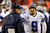LANDOVER, MD - DECEMBER 30:  Head coach Jason Garrett talks to Tony Romo #9 of the Dallas Cowboys after they failed to convert on a third down against the Washington Redskins at FedExField on December 30, 2012 in Landover, Maryland.  (Photo by Rob Carr/Getty Images)