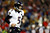 Joe Flacco #5 of the Baltimore Ravens runs off of the field against the New England Patriots during the 2013 AFC Championship game at Gillette Stadium on January 20, 2013 in Foxboro, Massachusetts.  (Photo by Jared Wickerham/Getty Images)
