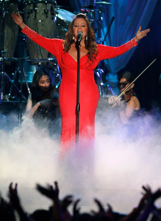 Description of . Mexican-American singer Jenni Rivera performs during the 2012 Billboard Latin Music Awards in Coral Gables, Florida in this April 26, 2012 file photo. Rivera is missing after the plane she was travel ling in disappeared shortly after leaving the northern Mexican city of Monterrey early on December 9, 2012. Rivera was heading for the city of Toluca in central Mexico after a concert in Monterrey on the night of December 8, 2012. The singer, two pilots and four other passengers are all missing, the ministry said. A search is continuing for the aircraft.     REUTERS/Andrew Innerarity/Files