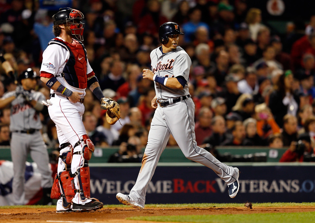 Description of . Victor Martinez #41 of the Detroit Tigers scores in the second inning against the Boston Red Sox during Game Two of the American League Championship Series at Fenway Park on October 13, 2013 in Boston, Massachusetts.  (Photo by Jim Rogash/Getty Images)