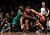Brooklyn Nets center Brook Lopez (R) drives to the basket defended by Boston Celtics forward Kevin Garnett in the second quarter of their NBA basketball game in New York, December 25, 2012.    REUTERS/Adam Hunger