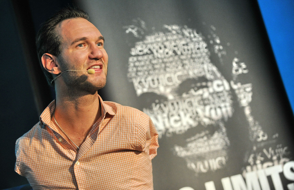 Description of . Australian motivational speaker, Nick Vujicic, who was born without limbs, speaks to the press before swimming in a shark habitat while protected within a customised acrylic enclosure at Marine Life Park, Resort World Sentosa in Singapore on September 5, 2013. Vujicic is in Singapore for a one-day event where he will be speaking to a 5,000 strong audience. ROSLAN RAHMAN/AFP/Getty Images