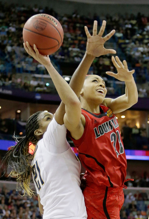 Description of . Louisville guard Bria Smith (21) goes up for a shot against California forward Reshanda Gray (21) in the first half of a national semifinal at the Women's Final Four of the NCAA college basketball tournament, Sunday, April 7, 2013, in New Orleans. (AP Photo/Gerald Herbert)