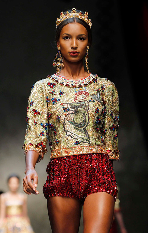 Description of . A model displays a creation from Dolce & Gabbana's Autumn/Winter 2013 collection at Milan Fashion Week February 24, 2013.  REUTERS/Alessandro Garofalo