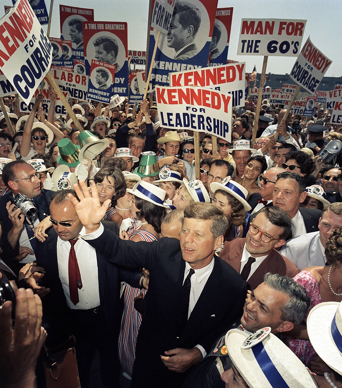Description of . Sen. Kennedy wades through a crowd of supporters and journalists as he arrives in Los Angeles on  July 9, 1960, for the Democratic National Convention. Associated Press file