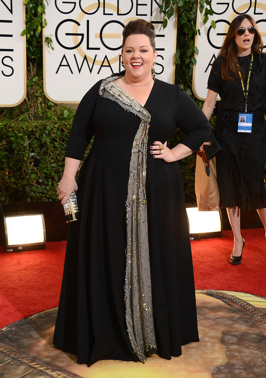 Description of . Melissa McCarthy arrives at the 71st annual Golden Globe Awards at the Beverly Hilton Hotel on Sunday, Jan. 12, 2014, in Beverly Hills, Calif. (Photo by Jordan Strauss/Invision/AP)