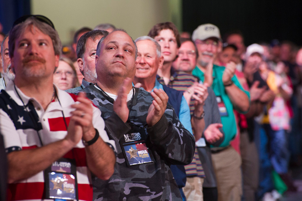 Description of . Attendees applaud a speaker during the leadership forum at the National Rifle Association's annual convention Friday, May 3, 2013 in Houston. (AP Photo/Steve Ueckert)