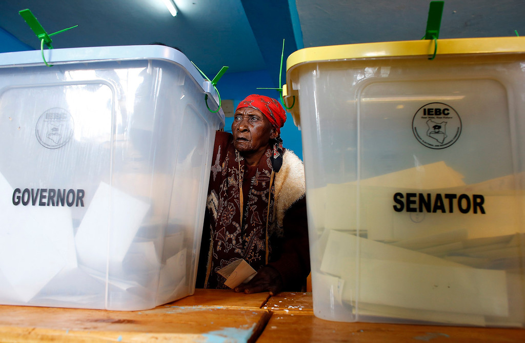 Description of . A woman casts her ballot inside a polling station in Kenya's town of Gatundu March 4, 2013. Polling stations opened up to Kenyans on Monday for a tense presidential election that will test whether the east African nation can repair its damaged reputation after the tribal blood-letting that followed a 2007 poll.    REUTERS/Marko Djurica