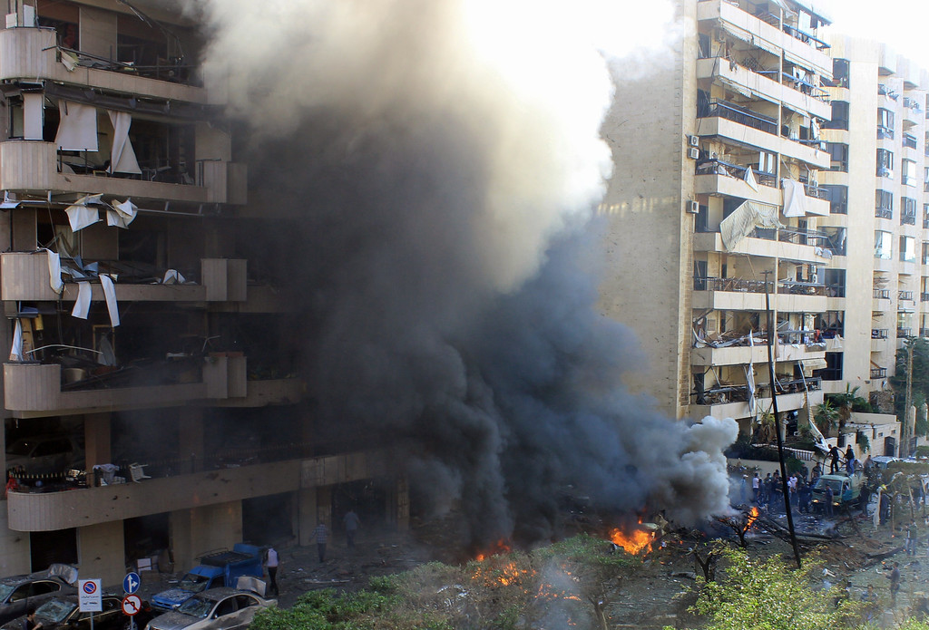 Description of . Flames rise from the site of a blast in Bir Hassan neighborhood in southern Beirut on November 19, 2013. At least 22 people were killed in a double bomb attack outside the Iranian embassy in Beirut, including an Iranian cultural advisor, government sources told AFP. AFP PHOTO/STR-/AFP/Getty Images