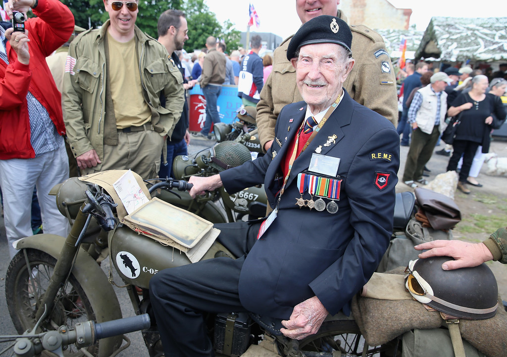 Description of . Henry McGill sits on a Matchless Motorbike during D-Day 70 Commemorations on June 5, 2014 in Ranville, France. Henry McGill was a dispatch rider on the bikes with the 5th Guards Armoured Division.   (Photo by Chris Jackson/Getty Images)