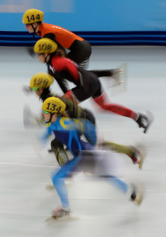 . Inna Simonova (134) of Kazakhstanthe, Ayuko Ito (129) of Japan, Marianne St-gelais (108) of Canada, Yara Van Kerkhof (144) of the Netherlands, start in a women\'s 500m short track speedskating heat at the 2014 Winter Olympics, Monday, Feb. 10, 2014, in Sochi, Russia. (AP Photo/David J. Phillip )