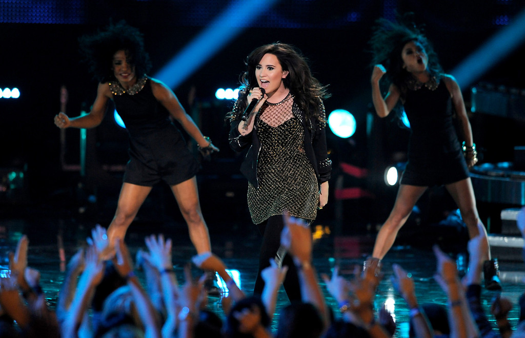 Description of . Demi Lovato performs at VH1 Divas on Sunday, Dec. 16, 2012, at the Shrine Auditorium in Los Angeles. (Photo by Chris Pizzello/Invision/AP)