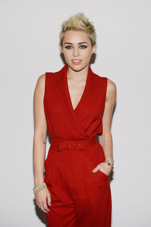 Description of . Miley Cyrus attends the Rachel Zoe Fall 2013 fashion show during Mercedes-Benz Fashion Week at The Studio at Lincoln Center on February 13, 2013 in New York City.  (Photo by Larry Busacca/Getty Images for Mercedes-Benz Fashion Week)