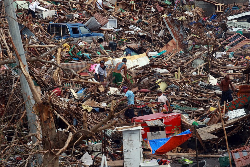 Description of . Residents salvage belongings from the debris surrounding their houses following the recent super typhoon on November 16, 2013 in Tanauan, Leyte, Philippines.  (Photo by Jeoffrey Maitem/Getty Images)