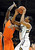 Spencer Dinwiddie of CU drives on Jarmel Reid of OSU during the first half of the March 9, 2013 game in Boulder.    (Cliff Grassmick/Boulder Daily Camera)