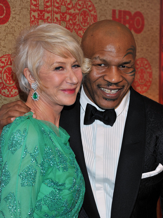 Description of . Helen Mirren, left, and Mike Tyson arrive at the HBO Golden Globes after party at the Beverly Hilton Hotel on Sunday, Jan. 12, 2014, in Beverly Hills, Calif. (Photo by Richard Shotwell/Invision/AP)